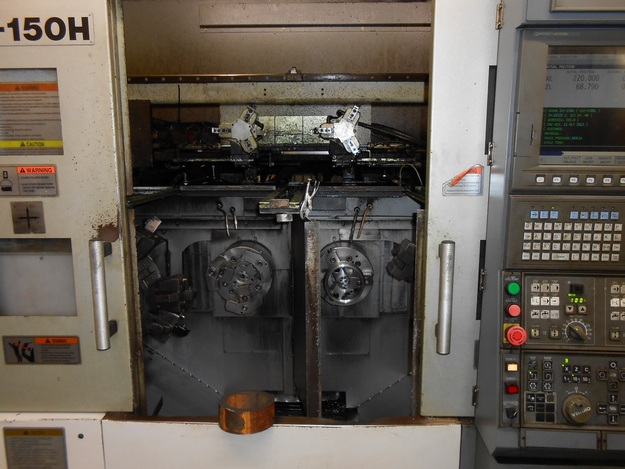 http://www.machinetools247.com/images/machines/14787-Okuma 2SP-150H 1.jpg