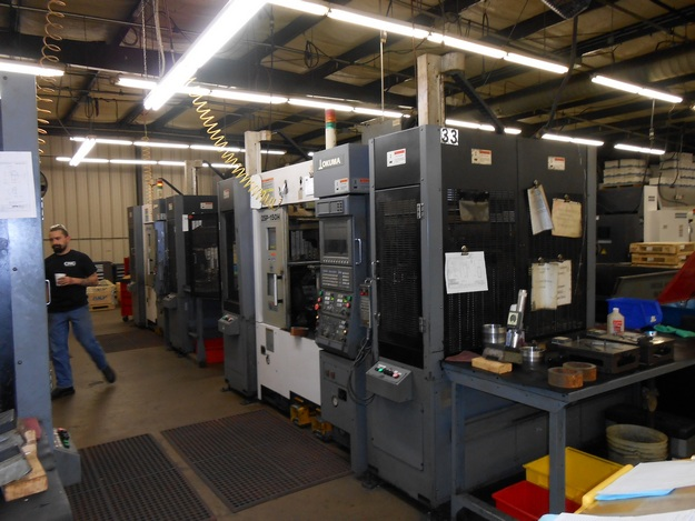 http://www.machinetools247.com/images/machines/14787-Okuma 2SP-150H 2.jpg