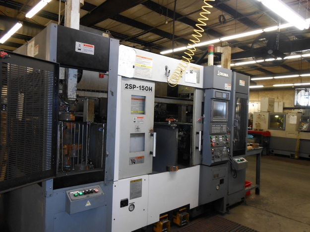 http://www.machinetools247.com/images/machines/14787-Okuma 2SP-150H.jpg