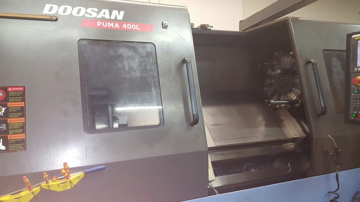 http://www.machinetools247.com/images/machines/14956-Doosan Puma-400 LC.jpg