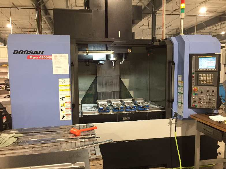 http://www.machinetools247.com/images/machines/16092-Doosan Mynx-6500 - 50.jpg