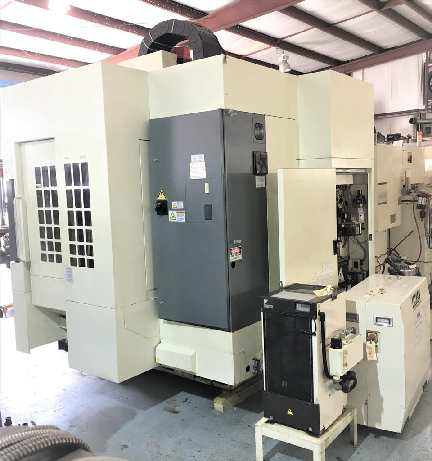 http://www.machinetools247.com/images/machines/16143-Kitamura Mycenter-3Xi Spark Changer 5.jpg