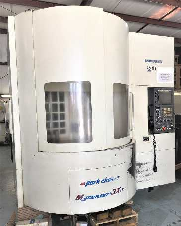 http://www.machinetools247.com/images/machines/16143-Kitamura Mycenter-3Xi Spark Changer.jpg