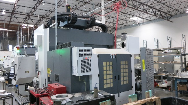 http://www.machinetools247.com/images/machines/16150-YCM DCV-2012B 4.jpg