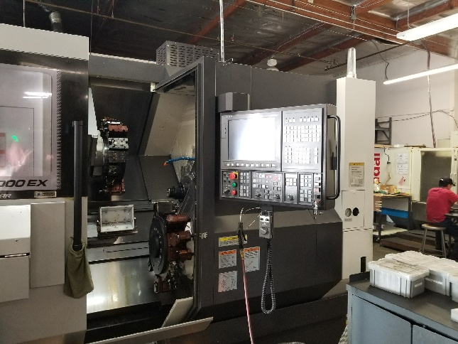 http://www.machinetools247.com/images/machines/16245-Okuma LT-2000 EX MY 2.jpg