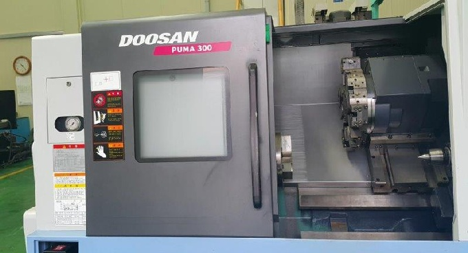 http://www.machinetools247.com/images/machines/16628-Doosan Puma-300 C 1.jpg